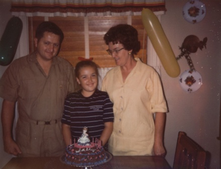 My mom and dad with me on my tenth birthday.  Every year my mom made me a birthday cake, usually my favorite - carrot cake - complete with scalloped frosting around the edges and 'Happy Birthday Sally!' written across the top.  We may not have carrot cake this year, but being able to celebrate another year with them is priceless.