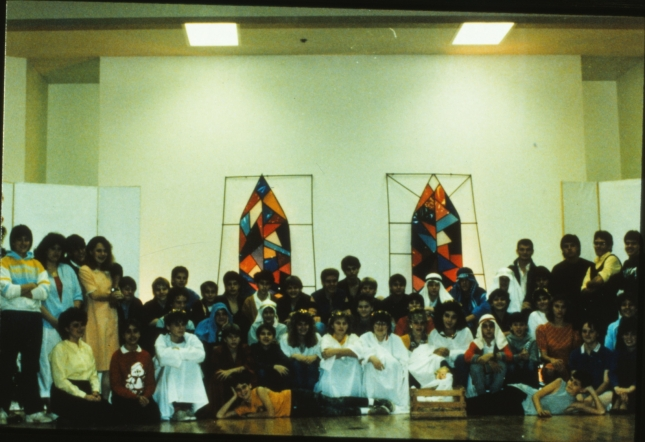 "Here's the whole cast from our first fall production at Wylie High School in 1986.  The white walls and fluorescent lights of our cafetorium ""stage"" was always a challenge, but I had so much fun working with these kids.    Can you find yourself in this picture?!  Let me hear from you if you can!"