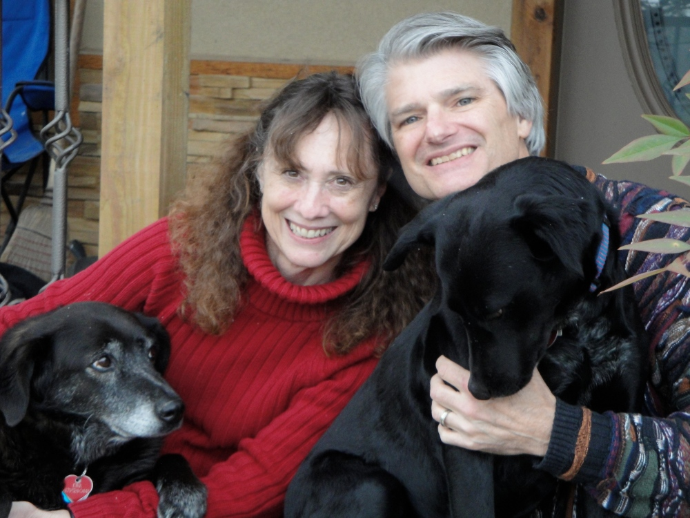 Lissa and Rich, with their dogs, Kyna (left) and Zoe (right)