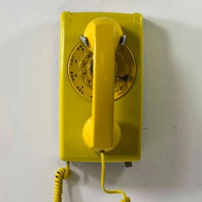 to pick up the mustard yellow phone mounted on our kitchen wall